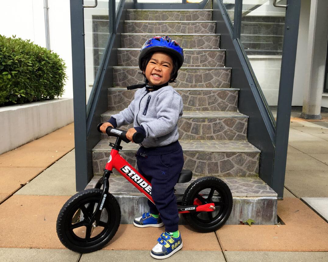 """Boy on Strider 12"""" Balance Bike"""